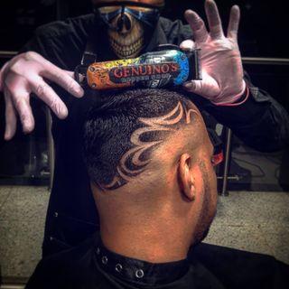 Logo de genuino's barber shop
