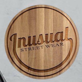 Logo de INUSUAL tienda de Ropa